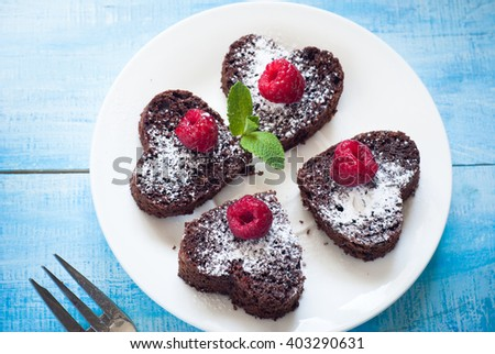 Brownie heart-shaped, decorated with berries. Chocolate dessert. - stock photo