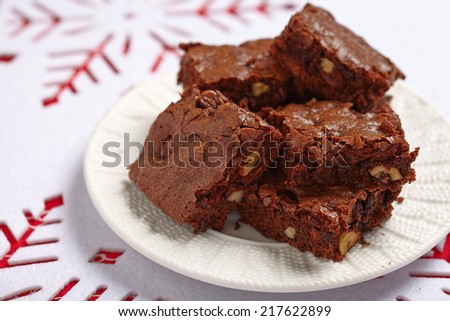 Brownie squares with chocolate chips and nuts - stock photo
