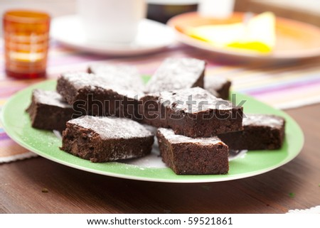 Brownies covered with icing sugar - stock photo