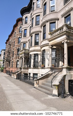 Brownstone and Limestone Residential Home Dwellings in Urban City Residential District Neighborhood - stock photo