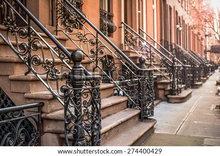 Brownstone apartment building entrances in New York City. - stock photo