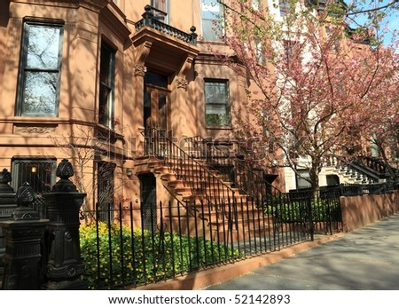 Brownstone apartment building on Berkeley Place in Spring in Park Slope, Brooklyn, New York - stock photo