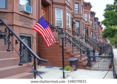 Brownstone Brooklyn Series/brownstone townhouses line block of the Sunset Park neighborhood of Brooklyn - stock photo