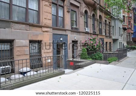 Brownstone Homes Urban Manhattan  Residential Neighborhood New York City - stock photo