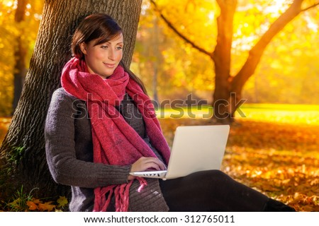 browsing the web in fall season - stock photo