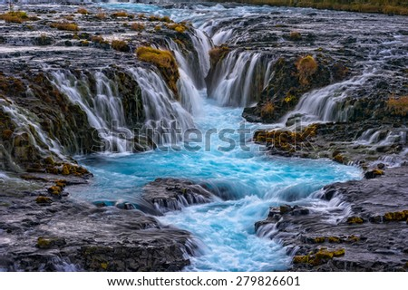 Bruarfoss (Bridge Fall), is a waterfall on the river Bruara, in southern Iceland where a series of small runlets of water runs into a beautiful, turquoise-blue colored pool.    - stock photo