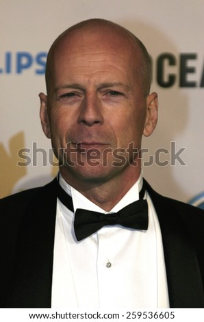 """Bruce Willis at the """"Ocean's Twelve"""" Los Angeles Premiere held at the Grauman's Chinese Theater in Los Angeles, California, United States on December 8, 2004. - stock photo"""
