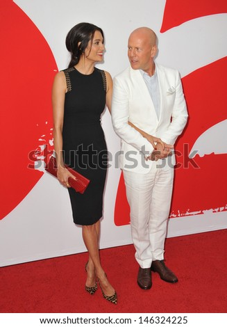 """Bruce Willis & wife Emma Heming at the Los Angeles premiere of his new movie """"Red 2"""" at the Westwood Village Theatre. July 11, 2013  Los Angeles, CA - stock photo"""