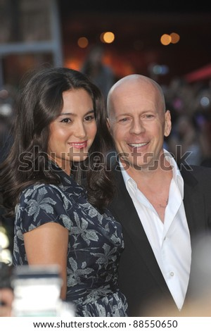 """Bruce Willis & wife Emma Heming at the world premiere of his new movie """"The Expendables"""" at Grauman's Chinese Theatre, Hollywood. August 3, 2010  Los Angeles, CA Picture: Paul Smith / Featureflash - stock photo"""
