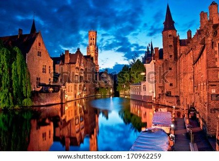 "BRUGES, BELGIUM - APRIL 20: Houses along the canals of Brugge or Bruges in the evening, Belgium on April 20, 2012. Bruges is frequently referred to as ""The Venice of the North"" for its canals."