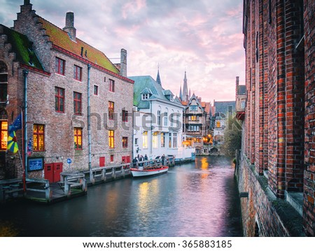 BRUGES, BELGIUM - DECEMBER 12: Illuminated river in the evening on December 12 in Bruges, Belgium. It is a city and a municipality located in the Flemish region. - stock photo