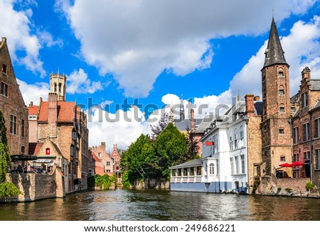 Bruges, Belgium. Image with Rozenhoedkaai in Brugge, Dijver river canal with Belfort (Belfry) tower. Flanders landmark. - stock photo