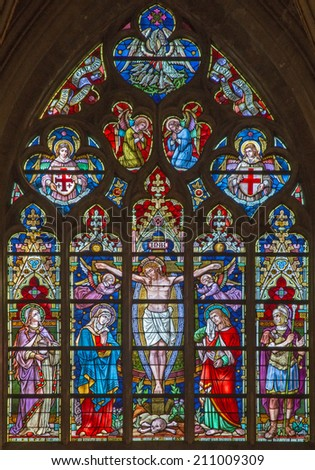 BRUGES, BELGIUM - JUNE 12, 2014: The Crucifixion on the windowpane in St. Salvator's Cathedral (Salvatorskerk) by stained glass artist Samuel Coucke (1833 - 1899).  - stock photo