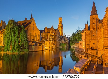 BRUGES, BELGIUM - JUNE 12, 2014: View from the Rozenhoedkaai in Brugge with the Perez de Malvenda house and Belfort van Brugge in the background in the evening dusk.