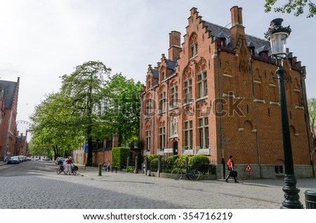 Bruges, Belgium - May 11, 2015: People around the Beguinage (Begijnhof) in Bruges, Belgium. Bruges is the capital and largest city of the province of West Flanders in the Flemish Region of Belgium.