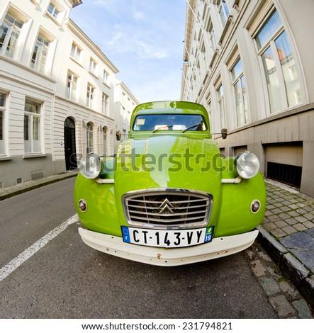 BRUGES, BELGIUM - OCTOBER 18: Old model Citroen car parked shooting by fish-eye lens in Bruges, Belgium in October 18, 2014 - stock photo