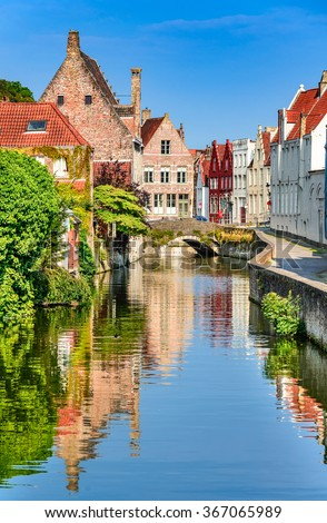 """Bruges, Belgium. Scenery with water canal in Bruges, """"Venice of the North"""", cityscape of Flanders, Belgium - stock photo"""