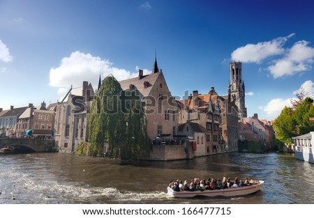 BRUGES, BELGIUM - SEPT 29: boat with tourists on channel, Bruges, Belgium, 29.09.2012. Bruges main town of the Belgian province the Western Flanders. One of the most picturesque cities of Europe.