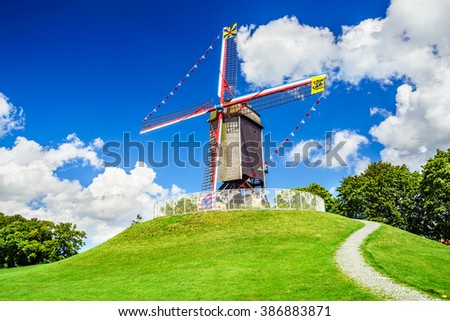 Bruges, Belgium. Sint Janshuismolen wind mill dating from 1770, still in its original spot, West Flanders - stock photo