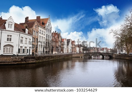 Bruges city street and canal - stock photo