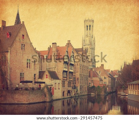 Bruges historic centre. The classic view from the Rozenhoedkaai. Belgium. Photo in retro style. Added paper texture. - stock photo