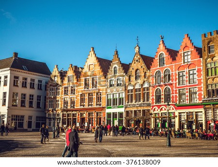 BRUGGE, BELGIUM - JANUARY 17, 2016: Christmas Grote Markt square in the beautiful medieval city Brugge at evening on January 17, 2016 in Brugge - Belgium.
