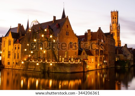 Brugge Belgium â?? November 25, 2015 : Long exposure of the city of Brugge in the night time with beautiful sky and tower in the background during winter time.