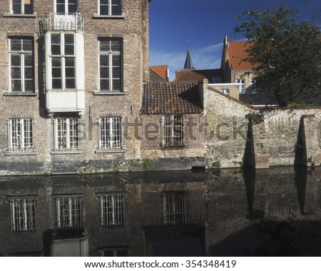 Brugge Bruges Belgium medieval buildings on canal made of brick and stone Europe - stock photo