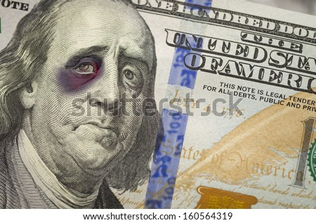 Bruised, Battered and Black Eyed Ben Franklin on the Newly Designed United States One Hundred Dollar Bill. - stock photo