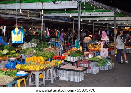 BRUNEI - 30 APRIL: An unidentified person buy vegetable, fruit and food on market in Brunei on April 30, 2010. These markets are known for cheap prices and high quality of goods. - stock photo