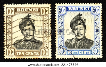 BRUNEI - CIRCA 1964: A pair of postage stamp printed in Brunei with portrait image of a Sultan Sir Omar Ali Saifuddin-Wasa'adul Khairi Wadin, the king of Brunei.
