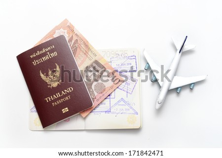 Brunei Darussalam banknotes and Thailand passport on the old book