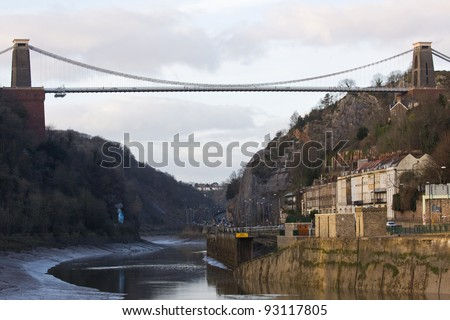 Brunel's landmark Clifton suspension bridge over the River Avon UK at low tide in midwinter - stock photo