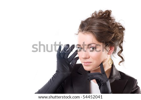 Brunet woman in black gloves. Make-up, hairstyle. Isolated.