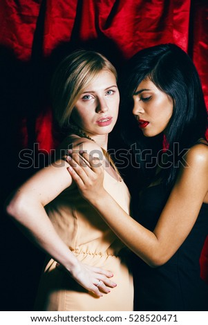 brunette and blond woman together friends, conflict of types