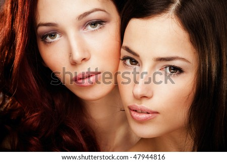 brunette and red hair woman beauty portrait - stock photo