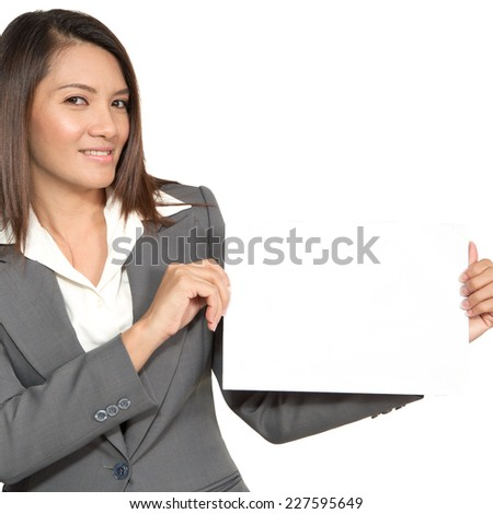 Brunette Asian businesswoman standing positive showing blank signboard, isolated on white background - stock photo