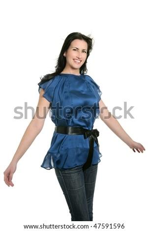 Brunette blue jeans dancing wind on hair studio white background - stock photo