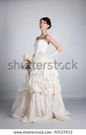 brunette bride portrait in studio - stock photo