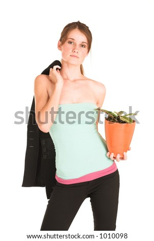 brunette business lady in light blue top and black pants.  Holding jacket and pot plant.