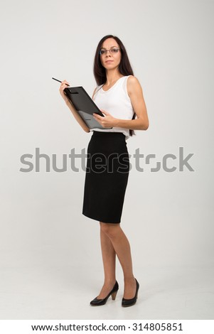 brunette business lady with paper clip board
