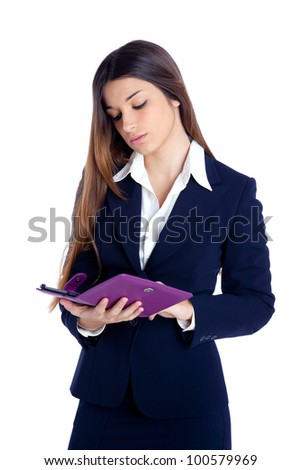 brunette business woman reading ebook tablet pc notebook and blue suit on white - stock photo