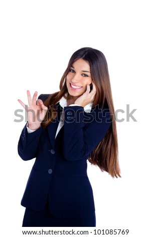 brunette business woman talking mobile phone happy smiling with blue suit on white - stock photo