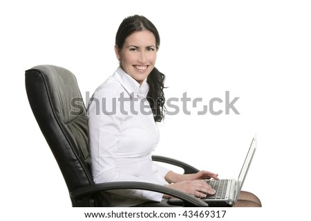 Brunette business woman typing laptop computer on office chair - stock photo