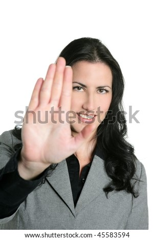 Brunette businesswoman hand stop sign on white background - stock photo