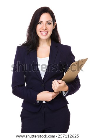 Brunette Businesswoman hold with clipboard - stock photo