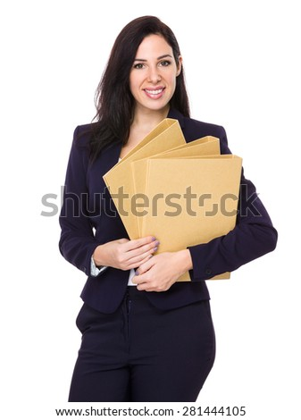 Brunette businesswoman holding with folder - stock photo