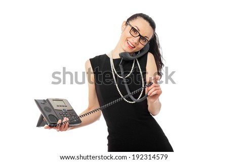 brunette  businesswoman in black dress holding telephone and talking over white background - stock photo