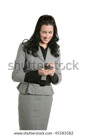 Brunette businesswoman sms message cell phone gray suit - stock photo