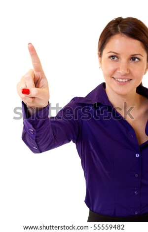 Brunette businesswoman touching virtual pad transparent key with finger - stock photo